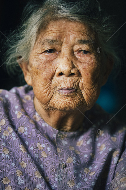 My Lai, Vietnam - October 3, 2017: A portrait of Ha Thi Qui, a survivor of the My Lai Massacre during the American-Vietnam War, at her home in central Vietnam