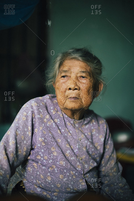 My Lai, Vietnam - October 3, 2017: Portrait of a survivor of the My Lai Massacre during the American-Vietnam War, at her home in central Vietnam