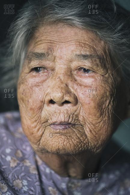 My Lai, Vietnam - October 3, 2017: Portrait of Ha Thi Qui, a survivor of the My Lai Massacre during the American-Vietnam War