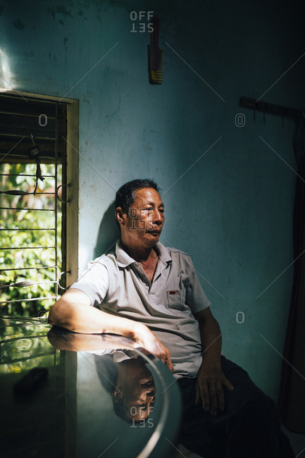 My Lai, Vietnam - October 3, 2017: A portrait of Nguyen Dinh, a survivor of the My Lai Massacre in 1968, at his home in Quang Ngai Province, central Vietnam