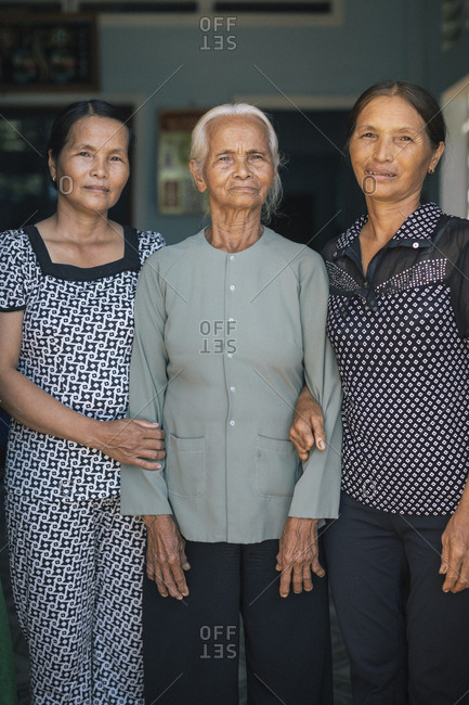 My Lai, Vietnam - October 4, 2017: Pham Thi Thuan, a survivor of the My Lai Massacre, with her two daughters at her home in Quang Ngai Province