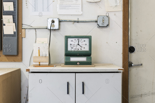Timeclock used to check in employees in a woodworking factory