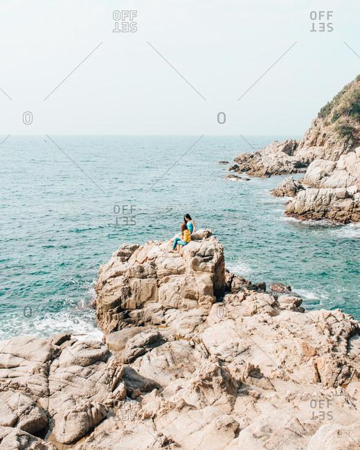 Costa Brava, Spain - May 12, 2018: Friends enjoying the oceanside views in Catalonia
