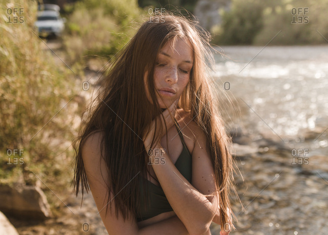 Young blonde girl poses touching her neck relaxing