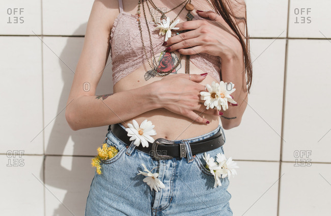 Young vintage with flowers girl poses white wall background