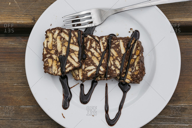 Italian dessert drizzled in chocolate sauce