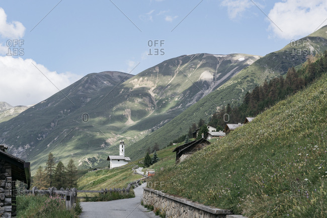 Country road through mountain village in the Italian Alps