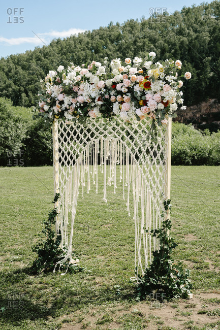 Wedding arbor with mesh net and flowers