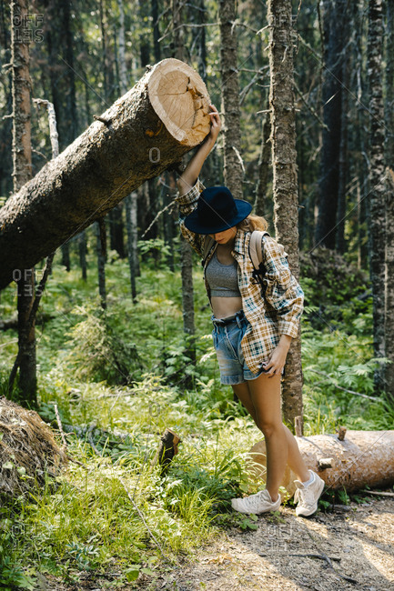 Young woman exploring forest in the Stolby Nature Sanctuary