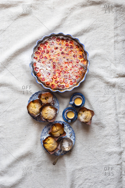 Gluten-free breakfast with cherry clafoutis, blueberry cornbread muffins, and espresso