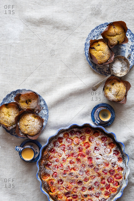 Gluten-free breakfast with cherry clafoutis, blueberry cornbread muffins, and coffee