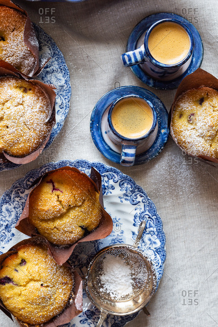Freshly baked gluten-free blueberry cornbread muffins served with espresso
