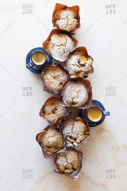 Homemade gluten-free blueberry cornbread muffins served with espresso