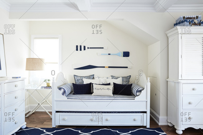 Los Angeles, California, USA - May 25, 2018: Bright white bedroom with nautical decor