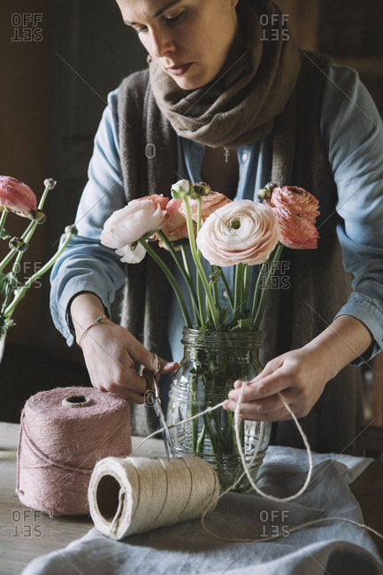 Woman arranging fresh flowers- cutting cord