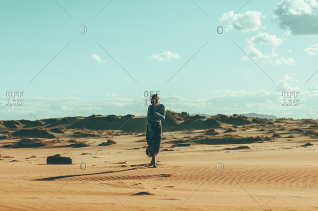 Young woman walking in desert landscape