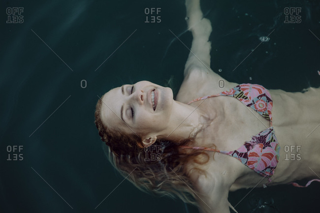 Carefree woman swimming in water
