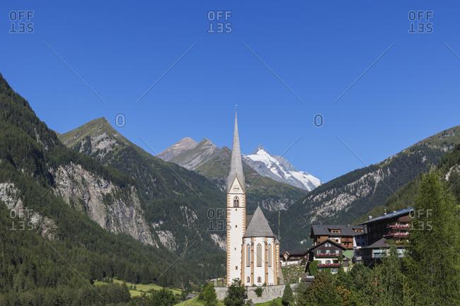 Austria- Carinthia- Heiligenblut am Grossglockner- Hohe Tauern National Park- parish church in front of Grossglockner