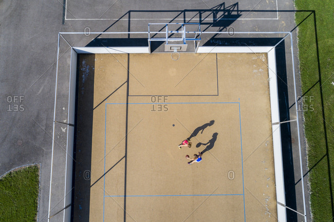 Young women playing basketball- aerial view