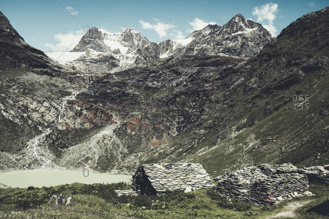 Italy- Lombardy- Campo di Moro- reservoir and peak of Piz Palue