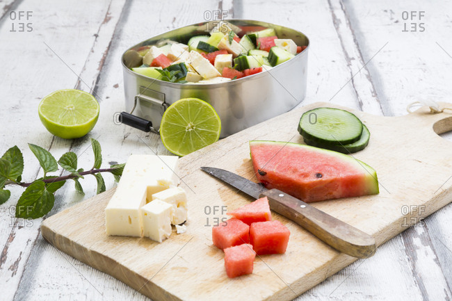 Lunch box- preparation of watermelon salad with feta- cucumber- mint and lime dressing