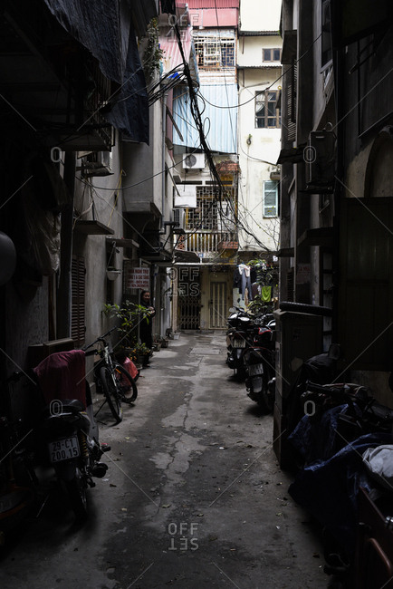 Hanoi, Vietnam - February 28, 2018: Narrow streets of Hanoi city center with bicycles and motorbikes everywhere