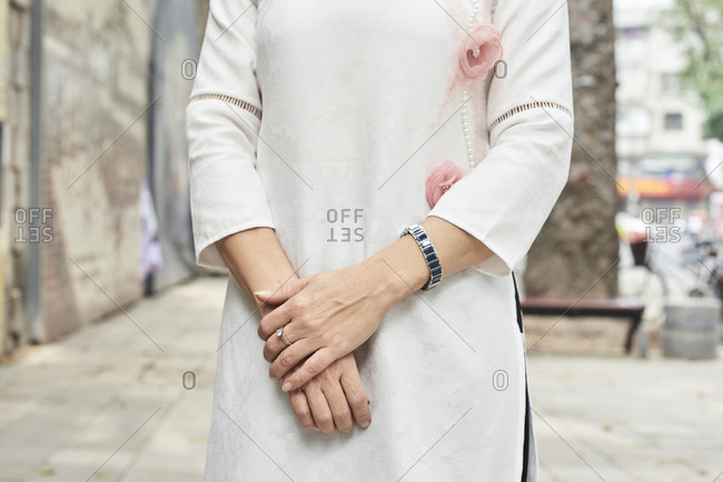 Details of elegant woman wearing traditional pastel costume for tet celebration, Hanoi, Vietnam