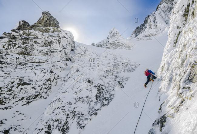 Distant view of mountain climber on easy pitch of Dobrucki route on Vysoka, High Tatras, Slovakia