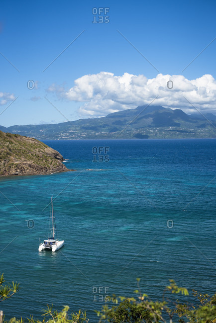 Distant view of catamaran sailing in sea, Bourg de Saintes, Isles des Saintes, Guadeloupe