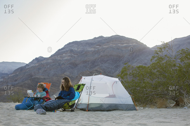 Boy and teenage girl camping in desert, Death Valley National Park, California, USA