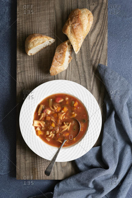 Bowl of Minestrone soup and crusty bread