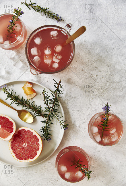 Freshly made grapefruit mock tail drink with rosemary