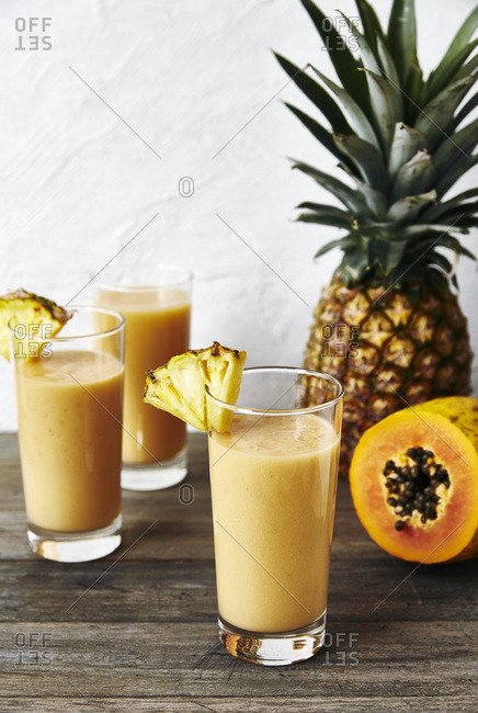 Healthy tropical fruit smoothie: coconut water, pineapple, pawpaw, banana