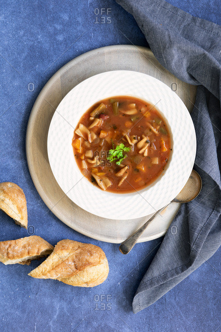Bowl of Minestrone soup with crusty bread