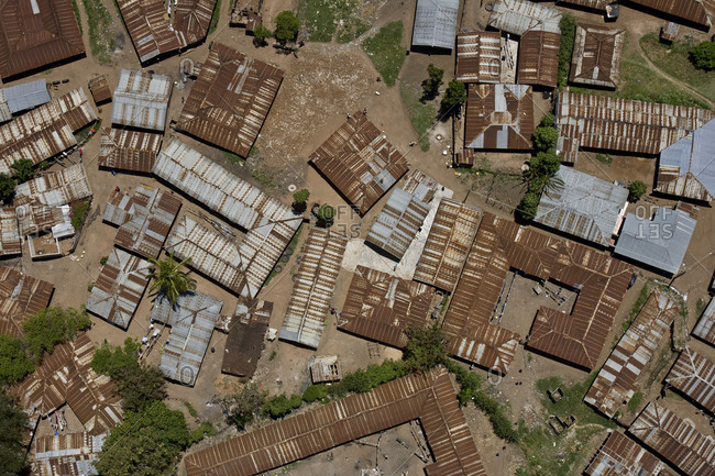 An aerial view of rooftops.