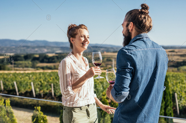 Couple enjoying drinking wine at vineyard