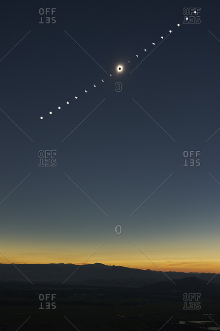 Solar eclipse phases above Grand Teton National Park, Wyoming