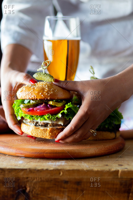 Woman eating gluten-free hamburger
