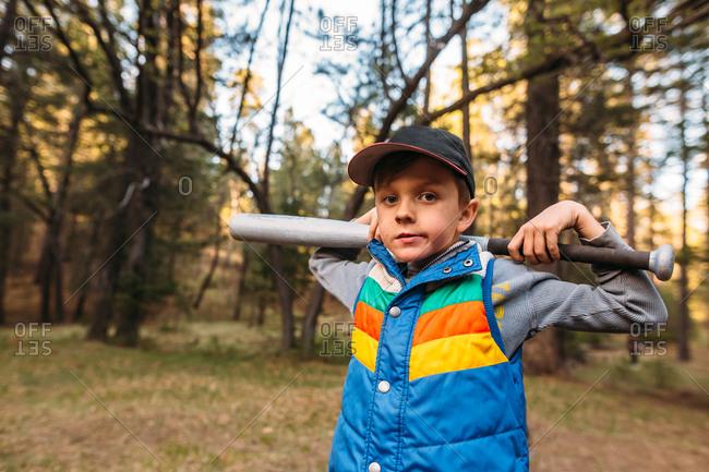 Boy holding a baseball bat on his shoulders
