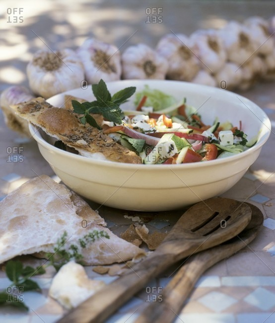 Summer salad with garlic, feta and toasted bread