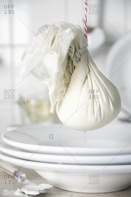 Quark wrapped in a cloth being drained