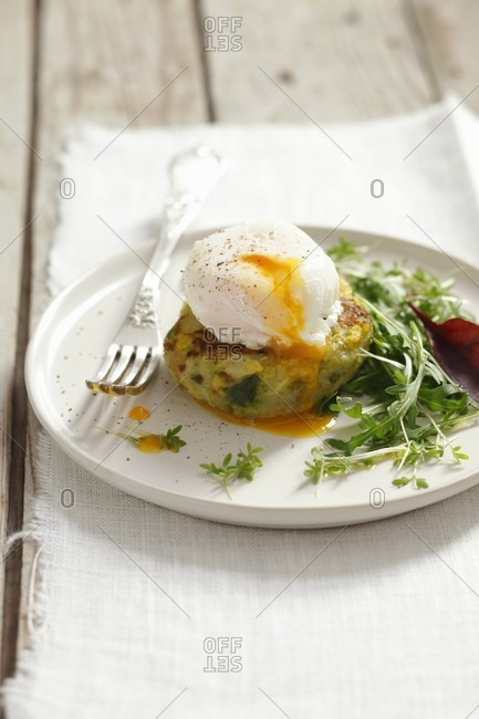 A poached egg on a potato and cabbage cake