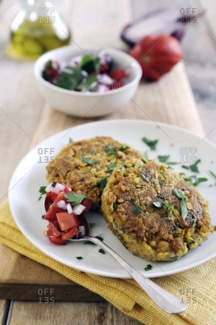 Pan-fried chickpea cakes spiced with cumin and coriander with fresh tomato salsa