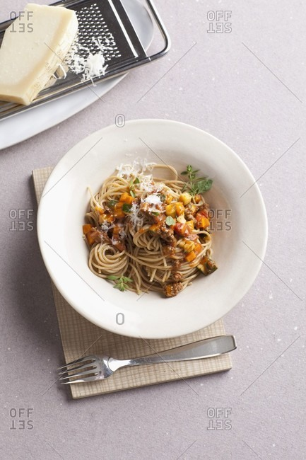Spaghetti with a minced meat sauce and Parmesan cheese
