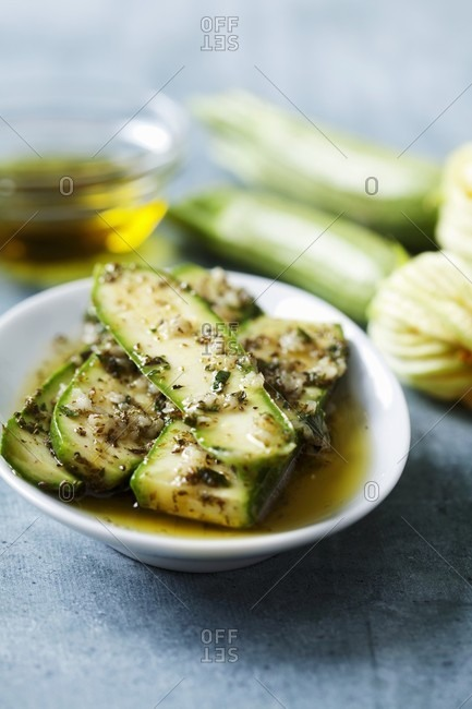 Courgette marinated with olive oil, garlic, oregano and salt (for barbecuing)