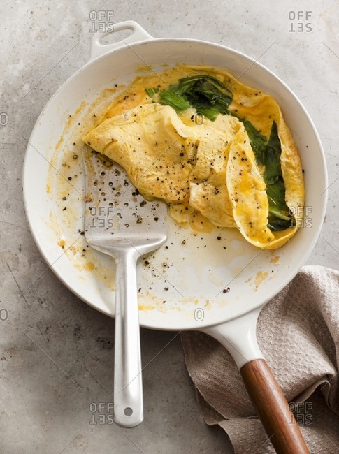 A spinach omelette in the frying pan