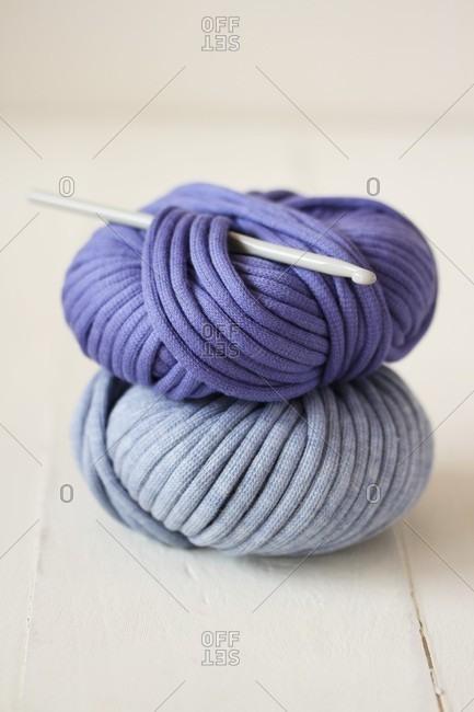Two balls of wool and crochet needle