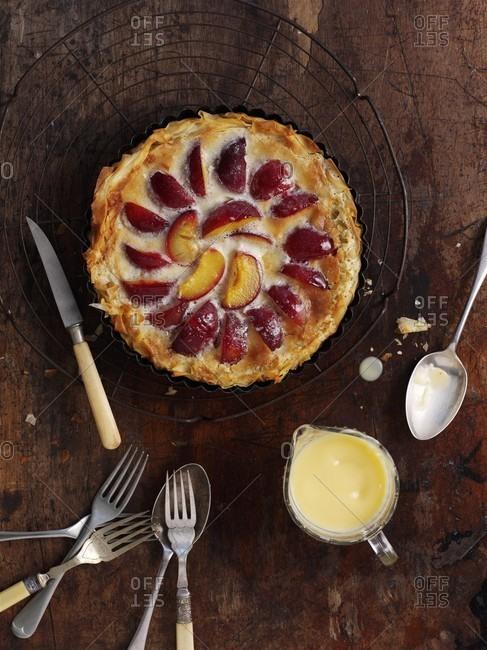 Plum tart with custard