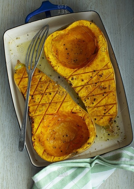 Roasted butternut squash in a roasting tin