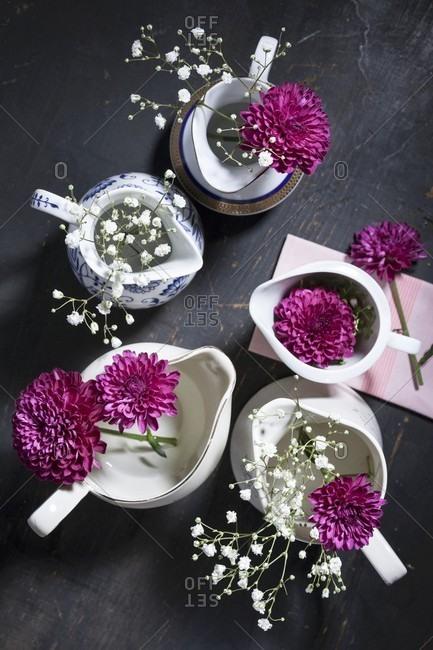 Purple chrysanthemums and gypsophila in jugs